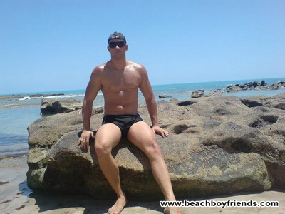 Amateur hunk boys wearing their tight trunks at the beach